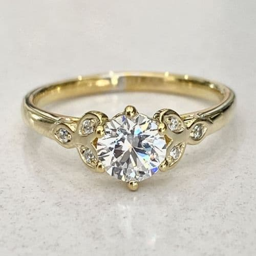 18ct yellow gold solitaire with blossom diamonds engagement ring