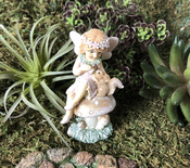 Vintage style woodland fairies - Fairy on a toadstool with her pet squirrel