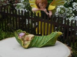 Woodland Knoll Leaf Baby - Miniature Garden Fairy baby sleeping in a leaf.